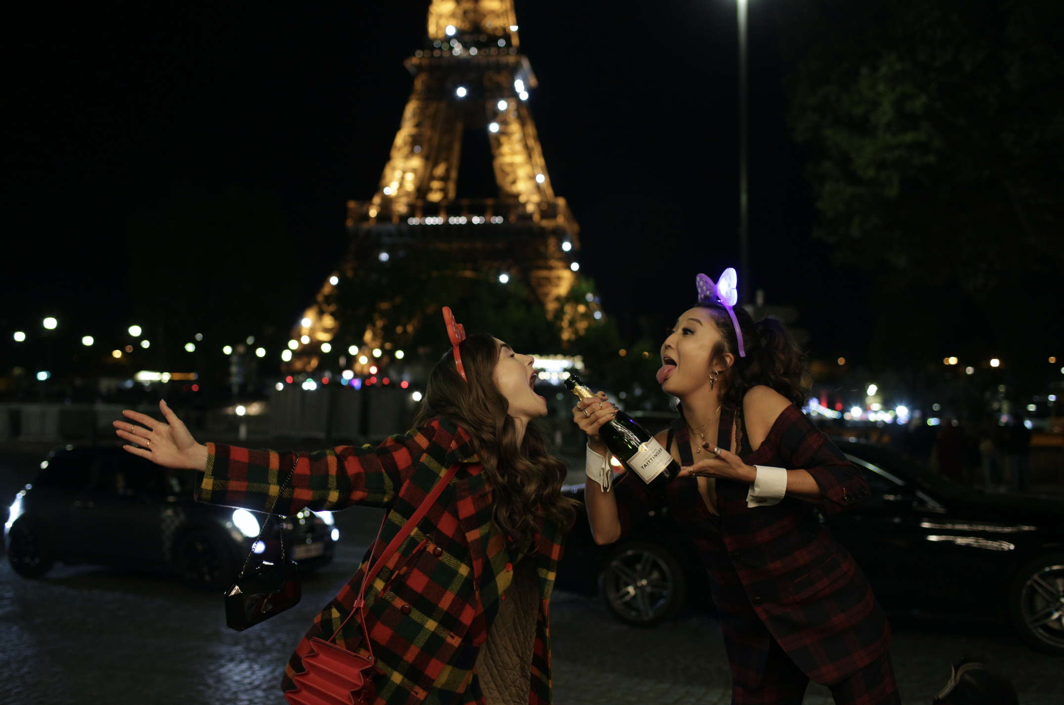 Lily Collins and Ashley Park in Emily in Paris. Photo courtesy of Netflix.   7 New Rules to Celebrate Christmas According to Netflix   The Little Binger